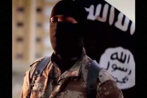 ISIS revela foto de criança a chutar cabeça decapitada