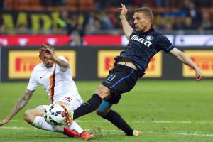 Podolski quer voltar ao Arsenal, revela Mancini