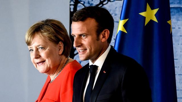 Merkel e Macron querem acordo para enviar migrantes para país de entrada