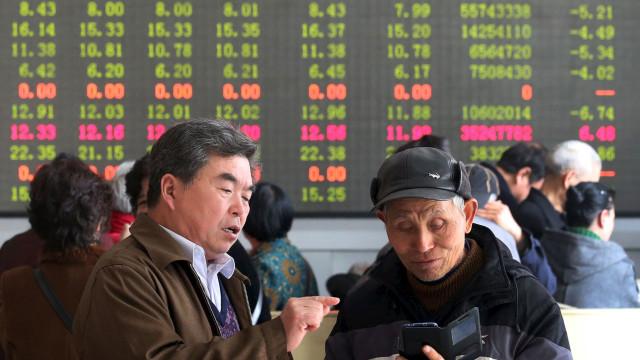 Japão e China acabam a semana de mãos dadas