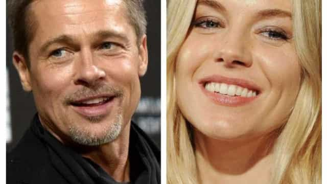 Brad Pitt e Sienna Miller trocam carinho em público
