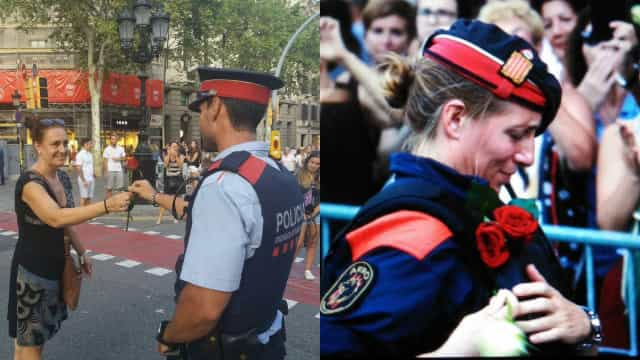 """Polícia catalã recebe homenagem popular. Rosas para os """"heróis"""""""