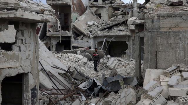 Da Síria chegam fotos de crianças assistidas. Regime nega ataque químico