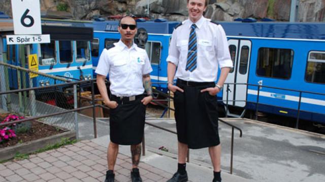 Proibidos de usarem calções, maquinistas suecos vestem saias